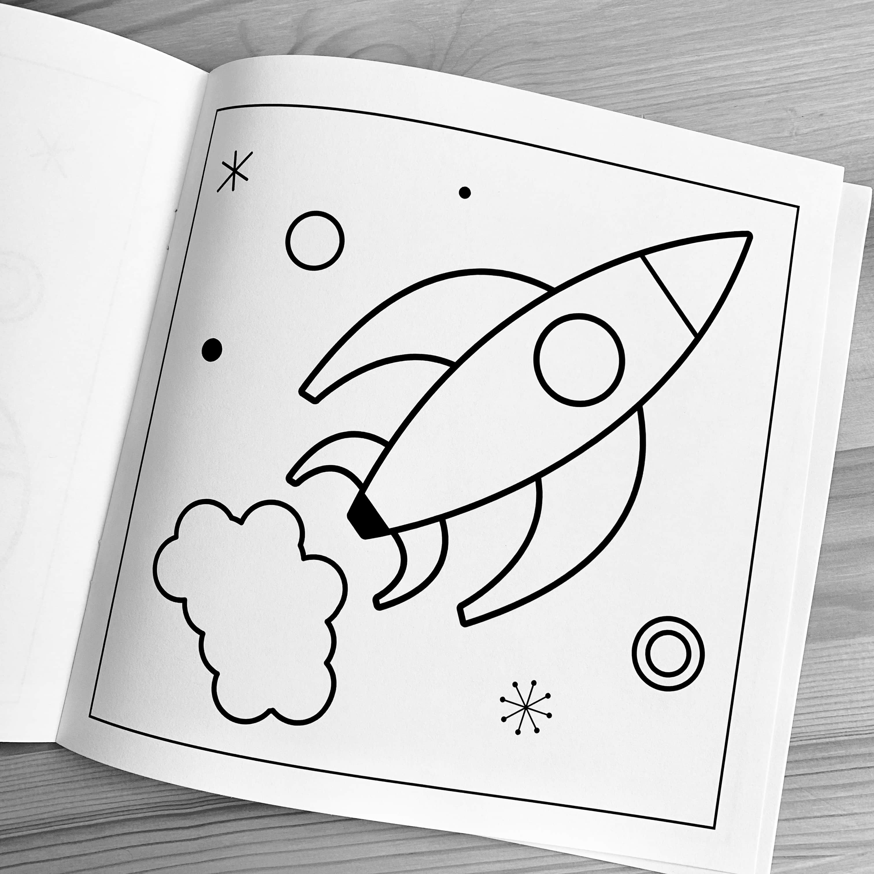 Photo of rocket print inside a coloring book